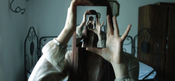 Person photographingthemselves in a mirror